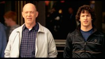 Peter's father Oz (J.K. Simmons) and younger brother Robbie (Andy Samberg) appear in an extended version of a scene from which they're absent in the film.