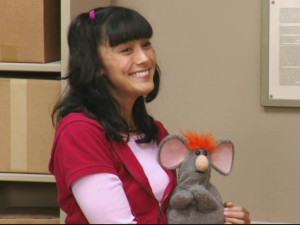 Nina (Wendy Calio) is all smiles, despite holding a mouse that fears for his life.