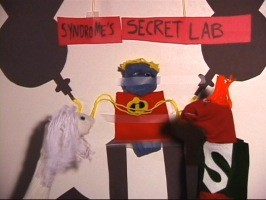 Low-tech Mirage, Mr. Incredible, and Syndrome in a scene from the puppet show Easter Egg.