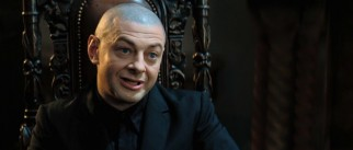 No longer reduced to motion capture, Andy Serkis (Gollum, Sméagol, King Kong) appreciates the way his bald, villainous head really pops against this dark backdrop.