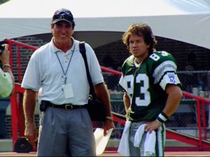 "The real Vince Papale stands next to the pretend Vince Papale (Mark Wahlberg) on the sidelines of ""Invincible."""