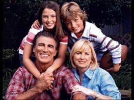 "Vince Papale poses with his wife Janet and two kids in a photo seen in the DVD's featurette ""Becoming Invincible."""