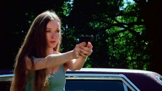 An ordinary handgun is too unimaginative a weapon for Jennifer Hills (Camille Keaton) to use to exact revenge on her rape gang ringleader.