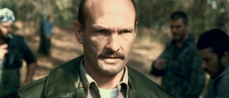 Sheriff Storch (Andrew Howard), a character invented for this remake, commands the men in evidence destruction.