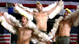 Dennis (Glenn Howerton), Mac (Rob McElhenney), and Charlie (Charlie Day) try to rev the crowd as the most patriotic of wrestling teams: the Birds of War.