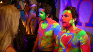 Charlie (Charlie Day) and Mac (Rob McElhenney) get the college experience they missed out with a neon body-painting party held at Dennis' old frat house.