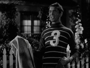 George Bailey (James Stewart) smiles at realizing the unusual situation befalling his dance partner.