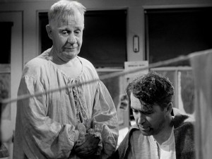 Second-class angel Clarence Odbody (Henry Travers) sees helping George (James Stewart) as the path to earning his wings.