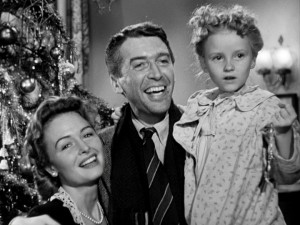 Mrs. and Mr. Bailey and daughter Zuzu are all smiles in the film's heartwarming closing moments.