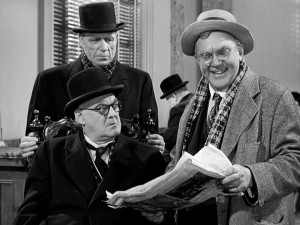 Scatterbrained Uncle Billy (Thomas Mitchell) shares some Bailey family news with grouchy Mr. Potter (Lionel Barrymore), in the scene that subtly supplies the film with its critical dilemma.