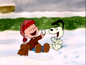 Rerun offers Snoopy a frosted cookie during one of their fun times together.
