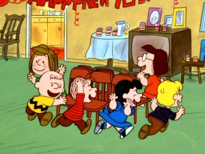 "Peppermint Patty, Charlie Brown, Linus, Lucy, Schroeder, and Marcie enjoy playing musical chairs in ""Happy New Year, Charlie Brown."""