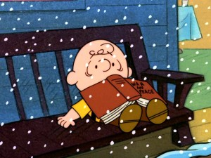 "Snow falls and Charlie Brown falls asleep with ""War and Peace"" as midnight and a New Year approach."