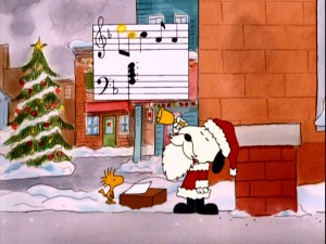 Santa Snoopy and Woodstock observe the Christmas season with some sidewalk bell-ringing and collecting.