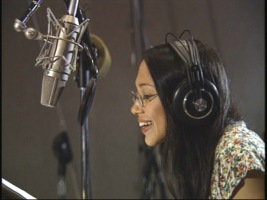 "Irene Bedard records the voice of Pocahontas, as seen in on-set footage from ""The Making of Pocahontas."""