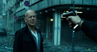 It's gonna take more than a gun pointed as his head to rattle John McClane (Bruce Willis).