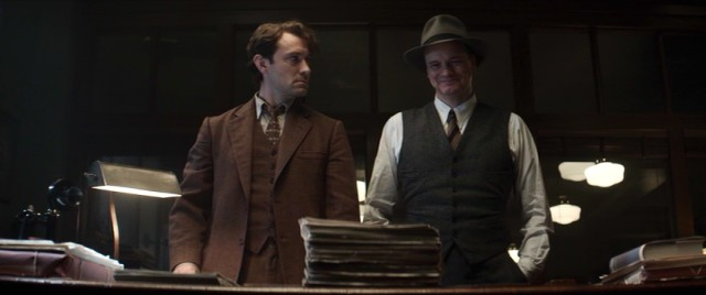 A last-minute title change from Thomas Wolfe (Jude Law) puts a smile on the face of his editor Max Perkins (Colin Firth).