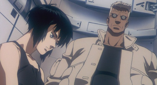 "Cyborg-bodied police officers Motoko and Batou ride an elevator to their destination in the 1995 Japanese anime ""Ghost in the Shell."""