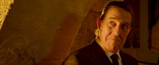 Ciarán Hinds plays the unenviable role of Roarke, a Devil of a man.
