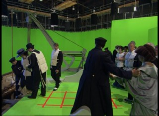 """Echoes in Time"" shows us glimpses of filming the green screen re-enactments integrated in the film."