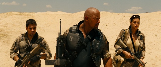 "In ""G.I. Joe: Retaliation"", a surprise air strike takes out all the G.I. Joes but Flint (D.J. Cotrona), Roadblock (Dwayne Johnson), and Lady Jaye (Adrianne Palicki)."