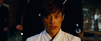 Snake Eyes is framed for the assassination and arrested, but inside his helmet is really Storm Shadow (South Korean actor Byung-Hun Lee).