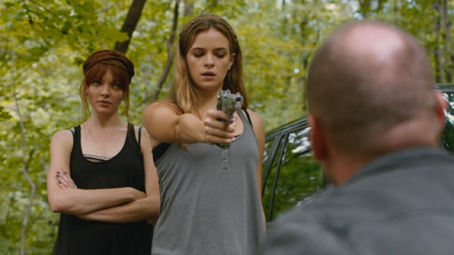 To the annoyance of jaded Lu (Nicole LaLiberte), Shae (Danielle Panabaker) hesitates to off her married boyfriend.
