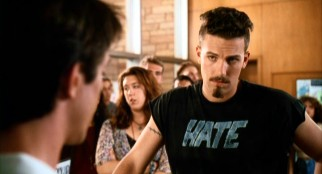 "Ben Affleck sports an interesting hairdo, a Van Dyck beard, and a Hate t-shirt in ""Glory Daze"", the first movie to utilize him as star."