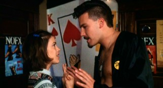 Amidst NOFX posters, Jack (Ben Affleck) deters the advances of Chelsea (Alyssa Milano) in deference to his friend Mickey.