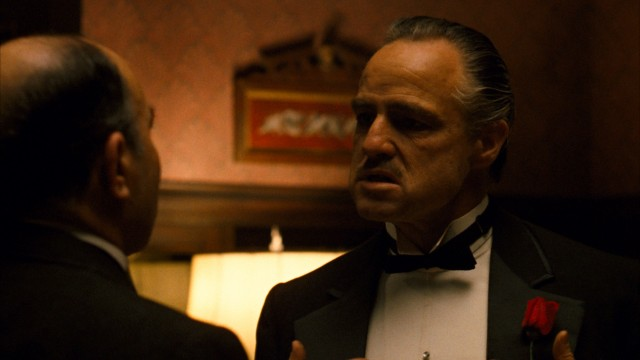 "An aged Marlon Brando plays Don Vito Corleone, who hears requests on the day of his daughter's wedding in the opening scene of ""The Godfather."""