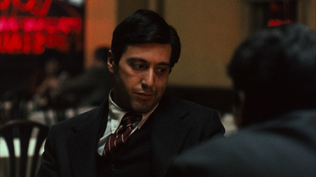 Michael Corleone (Al Pacino) meets with a police chief and a rival crime family's head at Louis Restaurant in a pivotal scene.