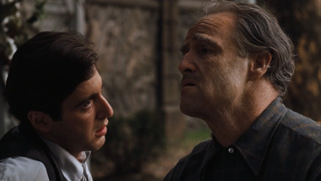The aging Don Corleone (Marlon Brando) shares a moment with the son (Al Pacino) who is about to take over the family business from him.