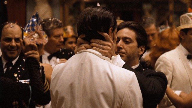 Celebrating New Year in Havana, Michael Corleone (Al Pacino) gives his brother Fredo (John Cazale) a kiss while acknowledging he knows of his betrayal.