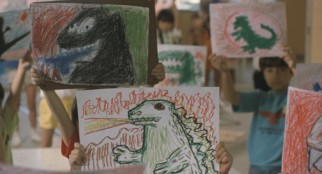 Children's drawings anticipate the return of Godzilla.