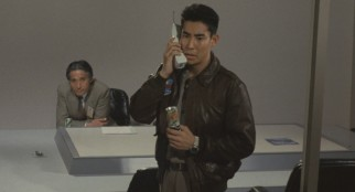 A tiny can of soda and a large cellular phone was the height of cool in 1989 Japan.