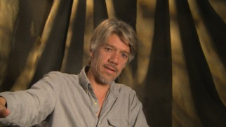 "Director Stephen Gaghan discusses ""Gold"" in making-of featurettes."