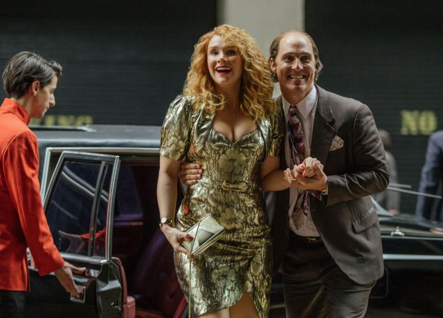 "A newly wealthy Kenny Wells (Matthew McConaughey) shows his longtime girlfriend Kay (Bryce Dallas Howard) a good time in ""Gold."""