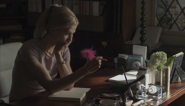 As her marriage flounders, Amy Dunne (Rosamund Pike) expresses her thoughts in a diary.