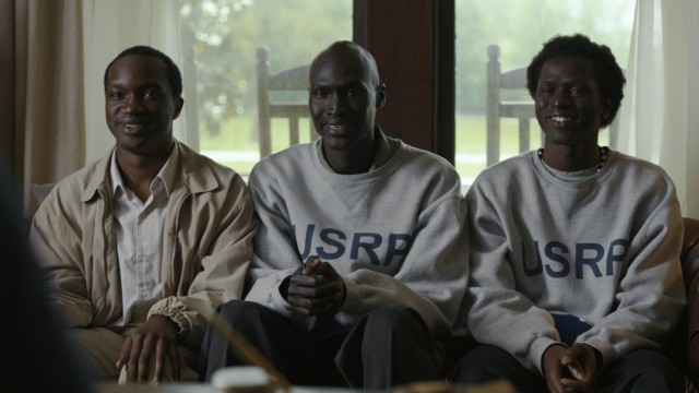 "In ""The Good Lie"", Sudanese refugees Mamere (Arnold Oceng), Jeremiah (Ger Duany), and Paul (Emmanuel Jal) learn the value of a fake smile on potential employees."