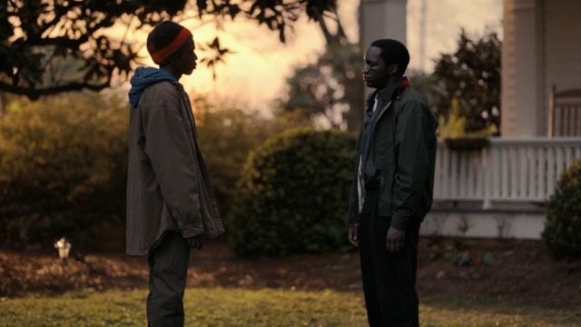 Paul (Emmanuel Jal) and Mamere (Arnold Oceng) make peace after a disagreement.