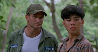 The friendship of Adrian Cronauer (Robin Williams) and Vietnamese teen Tuan (Tung Thanh Tran) has its pluses and minuses.