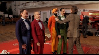 "Wes Anderson inspects the colorful concierges of the Society of the Crossed Keys in ""The Making of 'The Grand Budapest Hotel.'"""