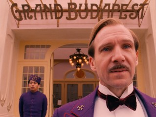 "M. Gustave (Ralph Fiennes) and lobby boy Zero (Tony Revolori) are the two constants running through the zany primary 1932 narrative of ""The Grand Budapest Hotel."""