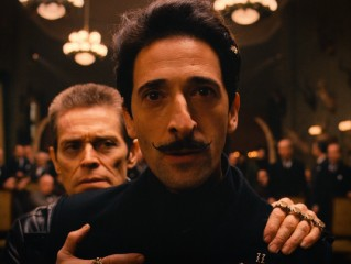Dmitri (Adrien Brody) and family friend Jopling (Willem Dafoe) are not at all pleased with Madame D's will.