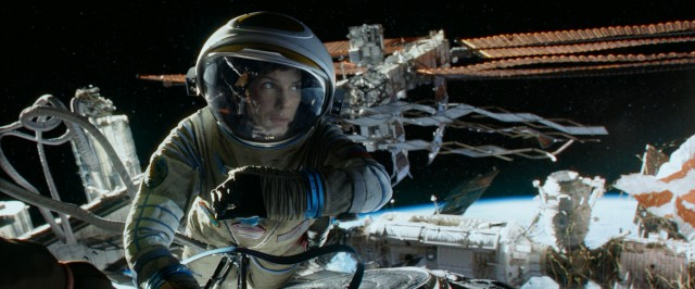 "Rookie astronaut Dr. Ryan Stone (Sandra Bullock) clings to a space station for life in ""Gravity."""