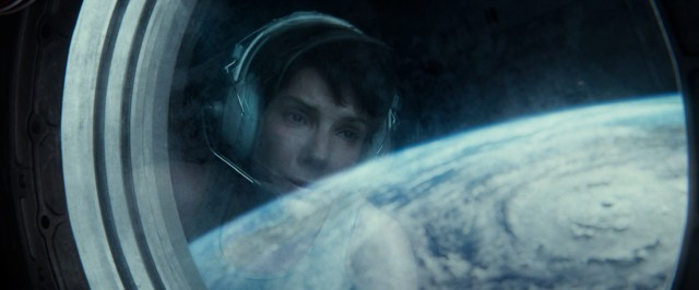 "Ryan Stone (Sandra Bullock) takes a look at Earth, a planet she desperately would like to return to alive in ""Gravity."""