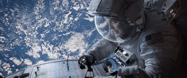 "Astronaut Matt Kowalski (George Clooney) works in full view of planet Earth in Alfonso Cuarón's ""Gravity."""