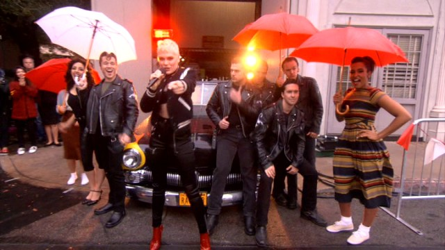 "A little rain can't stop Jessie J and umbrella-wielding cast members from kicking the show into gear with a lively performance of Franki Valli's theme song ""Grease."""