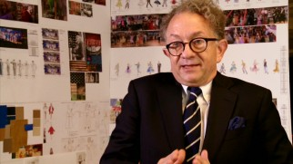 "William Ivey Long is excited to talk about his costume designs, drawings of which adorn the wall behind him in ""Greasin' Up the Joint."""