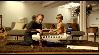 "Morgan Spurlock and his ""stunt son"" Joshua Wanatic play with figures on a model airplane in the film's JetBlue commercial."
